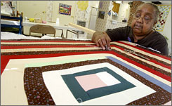 Nancy Pettway quilts in 2006 in Gee's Bend, home to the Gees Bend Quilters, a group of black women keeping the art of quiltmaking alive.