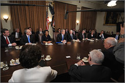 President Bush discusses his budget Monday with members of his Cabinet at the White House.