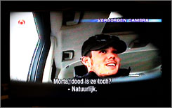 "Joran van der Sloot confessing to journalist Peter de Vries in a car about the death of Natalee Holloway, as broadcast on a Dutch television program. The banner at the top reads ""hidden camera"" and the subtitle reads:  ""So she is dead? Of course."""