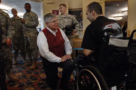 Chaplain David White, left, talks with Sgt. Jose Navarro at Walter Reed hospital on Saturday. Navarro was hurt in Afghanistan.