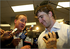 Eli Manning, right, just won the Super Bowl with the New York Giants. Eli's brother Peyton won the Super Bowl in 2007 with the Indianapolis Colts.