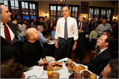 Mitt Romney visited the Pancake Pantry in Nashville, Monday, among other stops, telling people that rival John McCain is not a true conservative candidate.