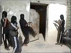 This image is a frame grab from a video that was discovered during a raid on an al-Qaeda safe house in Iraq. The video shows young boys being trained in kidnapping and assassination, the U.S. military said Tuesday.