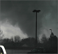 A funnel cloud of the tornado that touched down in Atkins, Ark., is seen at about 5 p.m. on Tuesday.