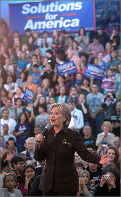 Sen. Hillary Rodham Clinton, D-N.Y., takes the stage for a campaign rally at Washington Lee High School in Arlington, Va., on Thursday.