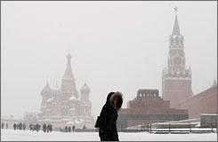 Young woman crosses Red Square in Moscow on Jan. 25 with the Kremlin in the background.
