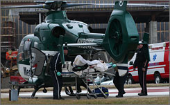 Christi Layne is wheeled to a medical helicopter Thursday, after being stabbed in her elementary school classroom in Portsmouth, Ohio, Thursday.