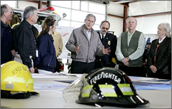 President Bush receives a damage briefing from state and local officials on tornado damage in Lafayette, Tenn., while touring the impact area.