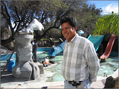 "Manager Crescenciano Montiel supervises the installation of a fountain at the Valle Paraiso water park in Ixmiquilpan, Mexico. ""Little by little, things have improved"" in Mexico, he says."
