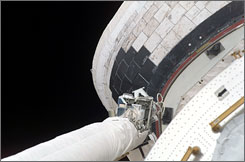 This handout image shows a slight protrusion of a thermal blanket on shuttle Atlantis' starboard Orbital Maneuvering System pod.