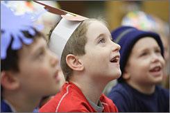 Maplebrook Elementary first-grader Steven Hughes, center, first-grader Justin Agema, left, and kindergartener Danny Press listen to Scieszka read from The Stinky Cheese Man in Naperville, Ill.