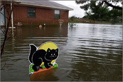 A Halloween decoration stands in a flooded front yard near Anardarko, in Caddo County, Okla., in October 2000. Caddo County, along with the Florida Keys, leads the nation in natural disasters, Federal Emergency Management Agency records show.