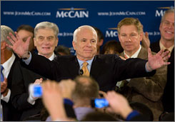 Republican presidential hopeful Sen. John McCain, R-Ariz., greets supporters following primaries in Virginia, Maryland, and the District of Columbia, on Tuesday in Alexandria, Va. He is flanked by Rep. Tom Davis, R-Va., right, and Sen. John Warner, R-Va., left.