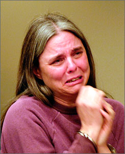 Lynn DeJac reacts back in November 2007 to a judge's ruling in State Supreme Court in Buffalo, after realizing she will be free on bail. The judge had ruled in favor of DeJac's  motion to have her second-degree murder conviction thrown out. On Wednesday, a prosecutor said forensic evidence had exonerated DeJac.