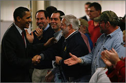 Democratic presidential hopeful Barack Obama, senator from Illinois, greets greets autoworkers at a General Motors plant in Janesville, Wis., on Wednesday.
