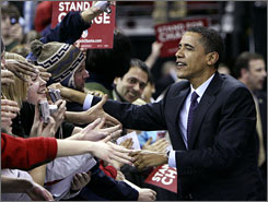 "Obama greets supporters at a rally Tuesday night in Madison, Wis. The latest victories are ""unambiguously good news for Barack Obama and continues to add wind to his sails,"" says political scientist Paul Freedman of the University of Virginia. ""But it's still premature to say it's over."""
