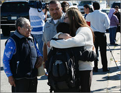 Students are reunited and comforted by their parents after a 15-year-old student at E. O. Green junior high school was shot and wounded on Tuesday in Oxnard, Calif. On Wednesday, police said the victim had died.