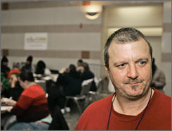 "James Bertan, 41, in Clevelandon Feb. 1. Bertan is a self-described ""bando,"" or person who lives in abandoned houses.  He has noticed the increased availability of boarded-up homes amid the foreclosure crisis."