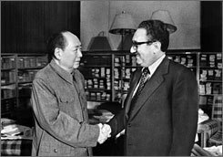 This file photo taken on November 24, 1973 shows Secretary of State Henry Kissinger, right, meeting with Chinese President Mao Zedong in Beijing. The Chinese leader proposed sending 10 million Chinese women to the United States,  according to documents released this week.