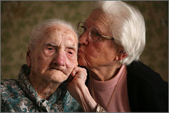 Cecelia Gulczinski kisses her mother, Catherine Hagel, at a nursing home in New Hope, Minn. At 113, Hagel is the oldest living Minnesotan ever. Although the nation's senior population isn't growing, the cost of elderly benefits are  and at a faster pace than the rate of enrollment and inflation.