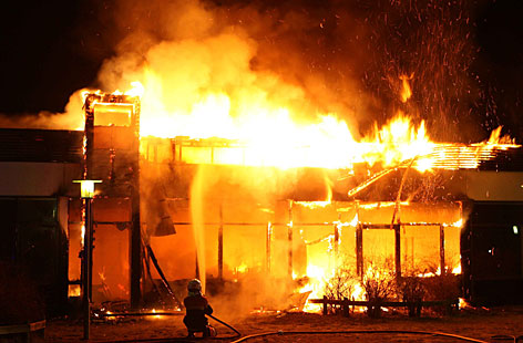 Vaerebro elementary school burns after being set on fire by demonstrators in Vaerloese north of Copenhagen, Thursday, in the fifth consecutive night of rioting.