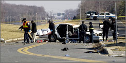 Emergency personnel tend to the scene of a car crash in Accokeek, Md., that left eight people dead.