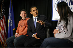 Democratic presidential candidate Barack Obama speaks with students Andrew Straub, left, and Kimberly Whitewater during a community meeting at Northcentral Technical College in Wausau, Wisc., on Saturday.