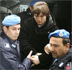 Raffaele Sollecito, accompanied by police, travels to speak with magistrates in Perugia in January.