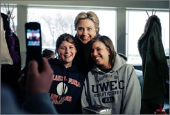 Democratic presidential hopeful Sen. Hillary Rodham Clinton, D-N.Y., poses for a photograph during a campaign stop at the Miss Katie's Diner in Milwaukee, Wis., on Sunday.