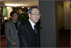Ban Ki-moon, secretary general of United Nations, smiles on his way to emergency Security Council consultations called by Russia regarding Kosovo's declaration of independence, at U.N. Headquarters on Sunday.