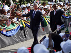 President Bush takes part in an arrival ceremony with Tanzanian President Jakaya Mrisho Kikwete at the State House in Dar es Salaam.