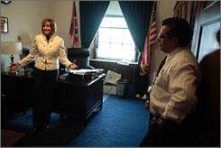 Representative Betty Sutton, D-Ohio, left, discusses defibrillator legislation with John Acompora on Capitol Hill in Washington on Feb. 13.