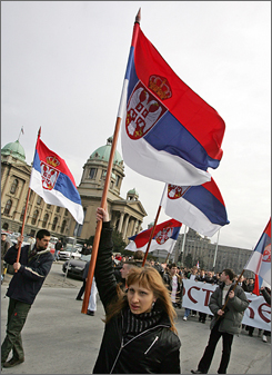 Serbian students wave flags during a protest in downtown Belgrade on Monday.