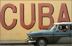 Vintage cars and national pride on the streets of Havana. European hotel chains have engaged in a building boom in Cuba, but the United States bans business with the island nation.