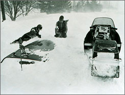 Photo from the winter of 1976-77 shows Red Cross workers searching for victims buried in cars in Buffalo after a blizzard.