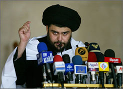 Radical Shiite cleric Muqtada al-Sadr speaks to supporters at his local mosque in Kufa, central Iraq, last May. The young leader of one of Iraq's most powerful armed movements decided to extend a cease-fire order until mid-August.
