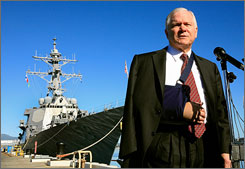 Defense Secretary Robert Gates stands in front of the U.S.S. Russell while talking about the recent missile launch to down a failed satellite, at Pearl Harbor Naval Base on Thursday in Honolulu. Gates says the U.S. will share some data about the downed satellite with China.