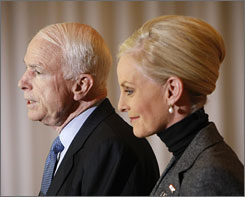 McCain, accompanied by his wife, speaks at a news conference in Ohio on Thursday morning.