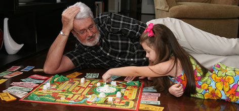 Richard Taylor, of Houston, plays a board game with his granddaughter, Christina Hakala, 7. Taylor is in the early stages of Alzheimer's. Sheer numbers of baby boomers are expected to fuel the increase of Alzheimer's cases from 5 million today to an estimated 11 to 16 million by 2050.