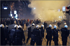 Serbian riot policemen face off rioters after an anti-Kosovo independence rally in Belgrade on Thursday.
