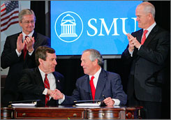 Southern Methodist University President R. Gerald Turner, left, and Donald L. Evans, chair of the George W. Bush Presidential Library Foundation signed an agreement Friday afternoon in Dallas that will place the presidential library at SMU.