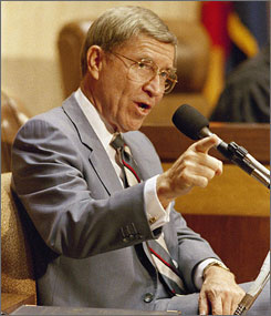 Former governor Evan Mecham gestures during his impeachment trial in 1988. Mecham died Thursday at age 83.