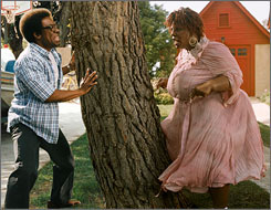 Eddie Murphy as Norbit  is shown in a scene with Rasputia, also played by Murphy, in Norbit. Murphy scored multiple Razzie nominations for his roles in Norbit.