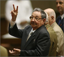 Raul Castro gestures during a meeting Sunday of the National Assembly in Havana.