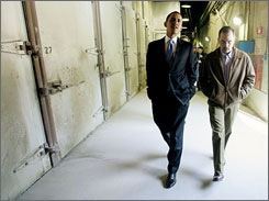Democratic presidential hopeful Barack Obama, senator from Illinois, walks with Tobin Ross, manager of the National Gypsum plant in Lorain, Ohio, on Sunday.