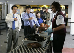 Transportation Security Administration screender Renee Duncan checks a passenger's show last fall at Newark International Airport.