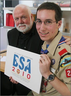 Philip Goolkasian, right, an Eagle Scout, and graphic designer Kit Hinrichs, show the new Boy Scouts of America 100th Anniversary logo, Feb. 1 in San Francisco.