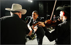 Obama shakes hands with members of the band Asleep At The Wheel during a fundraiser in Austin, Texas.