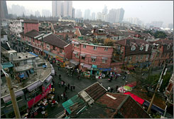 Human traffic moves about the old city zone of Shanghai. The global population is expected to leap from 6.7 billion to 9.2 billion by 2050. Urban living is expected to nearly double in that time, especially in Asia and Africa.
