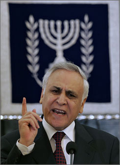 File photo of former Israeli President Moshe Katsav speaking during a press conference at his Jerusalem residence in Jan. 2007. Israel's Supreme Court upheld a much-criticized plea bargain by the ex-leader.